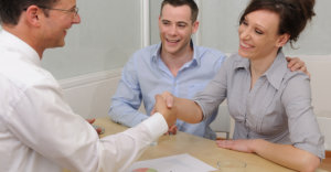 couple and lawyer with agreement